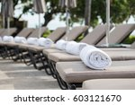 white towel roll on sunbeds at... | Shutterstock . vector #603121670