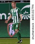 Small photo of BUDAPEST, HUNGARY - MARCH 11, 2017: Laszlo Kleinheisler of FTC fling out his arms due to the referee's decision during Ferencvarosi TC v Swietelsky Haladas OTP Bank Liga game at Groupama Arena.