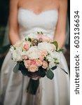 bride in a white dress is... | Shutterstock . vector #603136634