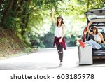 two young women with suitcases... | Shutterstock . vector #603185978