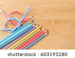 color pencils on wooden table... | Shutterstock . vector #603193280