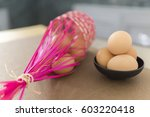 bowl of eggs in kitchen... | Shutterstock . vector #603220418