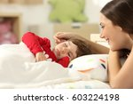 Affectionate Mother Looking At...