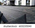 waterproofing flat roof with... | Shutterstock . vector #603235040