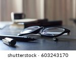 glasses and book on wooden... | Shutterstock . vector #603243170