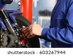 motorbike mechanic hands... | Shutterstock . vector #603267944