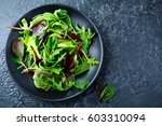 mix fresh leaves of arugula ... | Shutterstock . vector #603310094