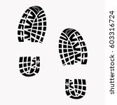 footprints from shoes.... | Shutterstock .eps vector #603316724