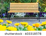 Wooden Bench Sits On The Garde...