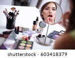 young beautiful woman making... | Shutterstock . vector #603418379