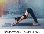 woman practicing yoga in a... | Shutterstock . vector #603431768