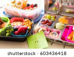 mom packs a happy note of... | Shutterstock . vector #603436418