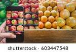choosing fruit by finger... | Shutterstock . vector #603447548