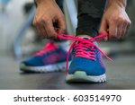 running shoes   woman tying... | Shutterstock . vector #603514970