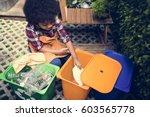 african descent kid separating...   Shutterstock . vector #603565778