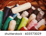 bobbins thread in willow basket ... | Shutterstock . vector #603573029