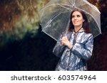 happy woman in raincoat with... | Shutterstock . vector #603574964