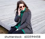 girl in coat and sunglasses... | Shutterstock . vector #603594458