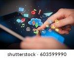 female hands touching tablet...   Shutterstock . vector #603599990