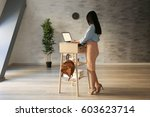 woman typing on laptop at stand ... | Shutterstock . vector #603623714
