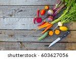 fresh vegetable on a wooden... | Shutterstock . vector #603627056