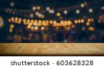 image of wooden table in front...   Shutterstock . vector #603628328
