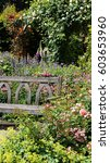Small photo of Take a seat in an English rose garden in summer, the warmth and perfume waft over you
