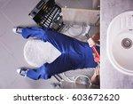 plumber repairing sink pipes in ... | Shutterstock . vector #603672620