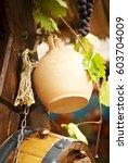 handmade jug  a wooden barrel... | Shutterstock . vector #603704009