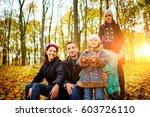 parents look at children in... | Shutterstock . vector #603726110