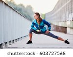 young woman runner stretching... | Shutterstock . vector #603727568