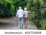 Old Couple Walking In The Park