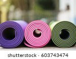 yoga mats on the wood table | Shutterstock . vector #603743474