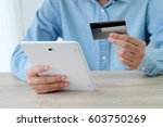 woman hands using tablet and... | Shutterstock . vector #603750269