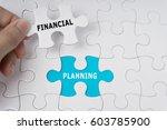 hand holding piece of jigsaw... | Shutterstock . vector #603785900