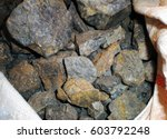 Small photo of Coltan ore contains metals of Tantalum and Niobium without them the productions of smart phones, laptops and condensers of all other electronic products related to contemporary world.