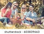happy young friends having... | Shutterstock . vector #603839663