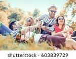 happy young friends having... | Shutterstock . vector #603839729