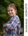 cute little girl outdoors  in... | Shutterstock . vector #603841970