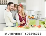 happy young family preparing... | Shutterstock . vector #603846398