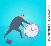 businessman rolls a clock. time ... | Shutterstock .eps vector #603863444