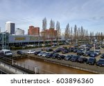 Small photo of Rotterdam, Netherlands, March 2017. Shopping mall Alexandrium with car park and shop logo's