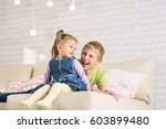 brother and sister are playing... | Shutterstock . vector #603899480