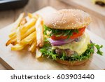 cheese burger and french fries... | Shutterstock . vector #603903440