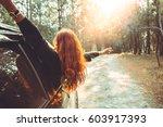 woman driving a car traveling...   Shutterstock . vector #603917393