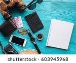 top view of travel accessories... | Shutterstock . vector #603945968