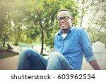happy african american man... | Shutterstock . vector #603962534