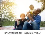 happy african american father ... | Shutterstock . vector #603967460
