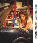 beautiful woman car mechanic in ... | Shutterstock . vector #603988658