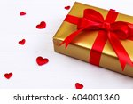 gift box with red satin hearts. ... | Shutterstock . vector #604001360
